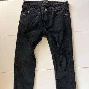 Skinny black destroyed jeans (frayed at ankles)